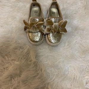 Gold canvas shoes